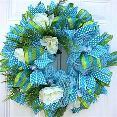 Brighten your front door or fireplace with this colorful wreath to usher in spring.
