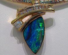 14k gold pendant with Boulder Opal and diamonds