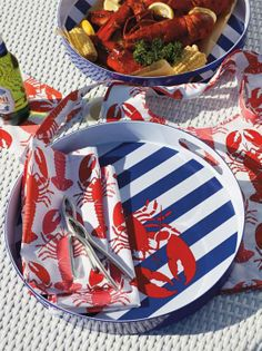 Make your next lobster bake a more seaworthy affair with the Kim Seybert Al fresco Lobster Collection.