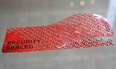 Etiquetas de seguridad grande en color rojo.