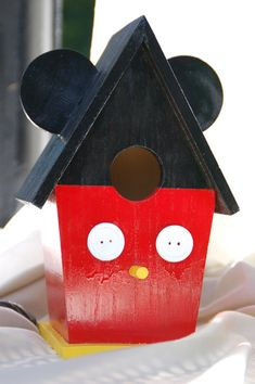 You could make this one with the kids - A Mickey birdie house:)