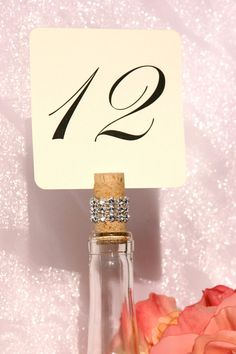 diy wine bottle table numbers | Wine Cork Table Number Holders for wine bottles trimmed with a crystal ...