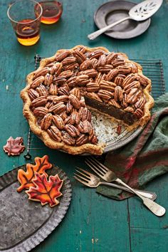 Salted Caramel-Chocolate Pecan Pie - 37 Caramel Dessert Recipes - Southernliving. A cross between a fudge pie and pecan pie, you can experiment with different looks by arranging the pecans however you like.Recipe: Salted Caramel-Chocolate Pecan PieCooking Video: Salted Caramel-Chocolate Pecan Pie
