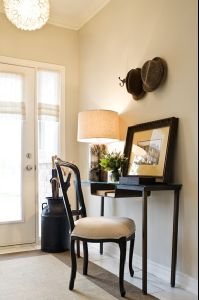 Functional foyer with soft sand beige walls paint color, Capiz chandelier, slim black console table desk, black chair and black umbrella holder. Hall Paint Colors, Hallway Colours, Wall Colors, Beige Wall Paints, Beige Walls, Neutral Paint, Modern Rustic Homes, Modern Rustic Decor, Interior Paint