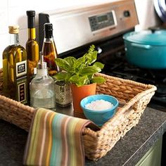 storage solutions using baskets: Kitchen Counter Basket - Use a shallow basket to organize cooking oils and spices. Line the bottom of the basket with a metal cookie sheet to making cleaning up inevitable spills easier. Kitchen Organization, Organization Hacks, Kitchen Storage, Kitchen Decor, Kitchen Styling, Basket Organization, Kitchen Tray, Kitchen Ideas, Kitchen Stuff