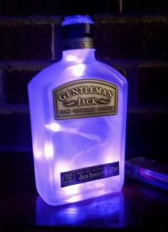 great Gentlemen Jack Rare Tennessee Whiskey 375 ml Multiple Colors Frosted Lighted bottle light Battery operated (comes with batteries) Comes in multiple colors -white, red, blue, pink, purple, yellow Great for bar man cave accent or home decor with frosted light set inside to illuminate the bottle. measures 7 1/4″ high and 3 …