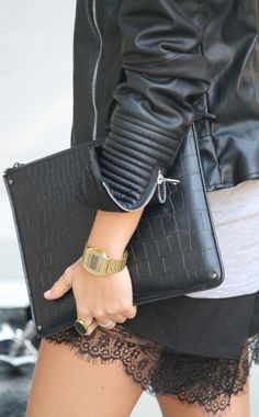 Just The Design: Camille Callen is wearing a black leather jacket with lace shorts from Sheinside and a gold Casio watch