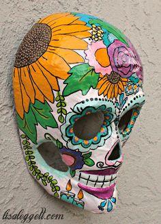 Floral themed Dia de los Muertos painted paper mache skull.