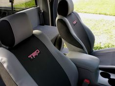 This seat cover is a wet suit-like material with a design enhanced by woven material, ribbed styling and TRD logo. This set of TRD Seat Covers is for the Sport Seats only. The color of the cover is black and graphite with a RED TRD logo. Toyota Tacoma Seat Covers, Toyota Tacoma Parts, 2015 Toyota Tundra, Toyota Tacoma Trd Sport, Sport Seats, Car Seats, Toyota Tundra Accessories, Truck Bed Camping, Tacoma Truck