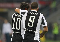 Gonzalo Higuain (R) of Juventus FC celebrates with his team-mate Paulo Dybala (L) after scoring the opening goal during the Serie A match between AC Milan and Juventus at Stadio Giuseppe Meazza on October 28, 2017 in Milan, Italy.