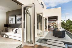 Bifold doors save space, and promote light, air and flow. Bifold Exterior Doors, Aluminum Pergola, Pool Remodel, Retractable Awning, Aluminium Windows, Types Of Doors, Folding Doors, Patio Doors, Windows And Doors