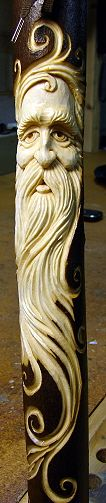 Wood Spirit Sticks by Shawn Cipa. These examples are carved of maple.  The maple stick is strong, lightweight once seasoned, and the carving shows up well against the dark brown bark. Nice curling too !