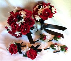Red rose Bridal bouquet in red white black wedding bouquet - I like the flowers and ribbon used, but maybe less bling on the bouqet stems?