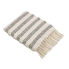 The simple three stripe design has a trim and masculine look on the White Throw Blanket with Black Stripes from Threshold. This striped throw blanket is softened by the look of the tassel fringe.