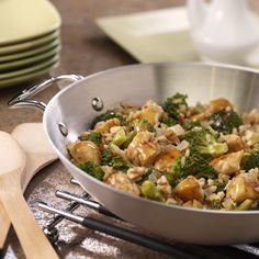 Spicy Ginger Stir-Fry: Stir-fried chicken, broccoli and brown rice in a spicy ginger sauce - this good-for-you recipe delivers on taste and satisfaction