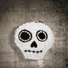 part of our vast range of halloween decorations this tinsel skull is great for hanging around