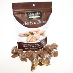 Betty's Bites! Delicious pretzel thins paired with our homemade caramel, covered in our special blend of milk chocolate and sprinkled with sea salt! 6oz resealable snack bag.