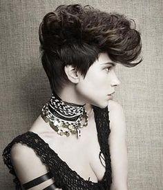 A daring creative quiff with piled-high necklaces and a black mesh top. #hairmeetwardrobe #hair #fashion