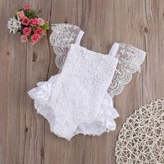 Beautiful lace romper features a flowing sleeve with ruffles upon ruffles on the back.  Adjustable strap tie back. High quality cotton, fits true to size.