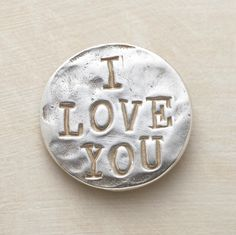 """A token of your love, hand cast in sterling silver and inscribed """"I love you."""" Reverses to """"with all my heart and soul."""" Made in the USA. 1-1/4"""" Dia."""