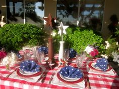 An American classic, the red and white check tablecloth, is the perfect foundation for any 4th of July table.