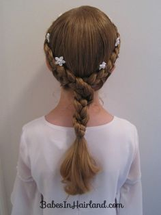 """Half french braids twist.  I'm thinking this might make a good """"Rapunzel"""" style?  The girl now asks for hair styles by the name of a certain princess :)"""
