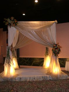 Elegant drapery on this gorgeous chuppa designed by Adam Leffel Productions