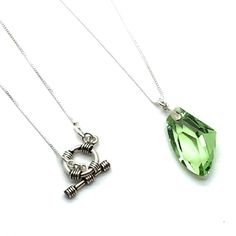 """Spring Green is an 18"""" Sterling Silver Box Chain Finished with a Toggle Closure and a 1"""" x ¾"""" Green Swarovski Crystal Pendant. Product # 15-108"""