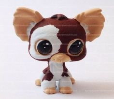 One of a Kind Custom LPS toy based on Gizmo from the 80's movie, Gremlins. He has been painted with artist acrylics and sealed with testors dullcote spray for the body and triple thick gloss on the eyes. This item is for display purposes only- it is not recommended for playing. Do not put in wate...