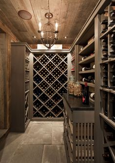 Wine Cellar Ideas.. Glass door in the middle of a wall with cabinets on either side