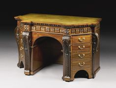 A George II style mahogany kneehole desk late 19th/early 20th century in the manner of William Kent, the shaped top with a tooled leather insert above three frieze drawers and two pedestal cupboard doors fashioned as dummy drawers, one enclosing adjustable shelves the other three drawers, on a plinth with concealed castors