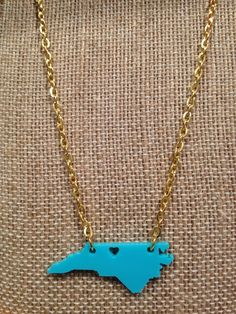 "Greensboro North Carolina Love $22.95  18"" chain, in gold or silver, green, turquoise, or red. 336-272-1800 to place your order and we ship to you.  www.shopdesignarchives.com"