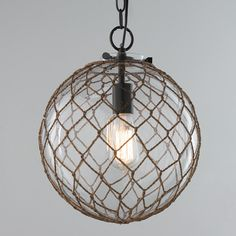 """Nautical Rope Pendant Globe This rope wrapped bubble glass globe gives a modern spin on a nautical theme. Ideal for either contemporary or coastal design. 1 light, Up to 100 watts. (15 """"Hx12""""W)"""