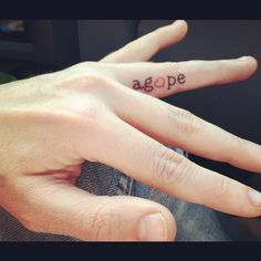 my first tattoo. Agape - greek word for the spiritual love between God and man. On the inside of my ring finger symbolizing that God is my first love.