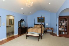 This traditional home takes blue to the next level by using the color in a number of rooms.