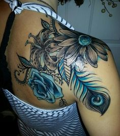 Flower tattoo shoulder piece- peacock feather and teal, my favorite! Sunflower, lily, and rose.