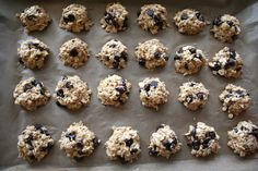 healthy cookies 4- 3 large, ripe bananas, well mashed (about 1 1/2 cups) 1 teaspoon vanilla extract 1/4 cup coconut oil, barely warm – so it isn't solid (or alternately, olive oil) <–i used grapeseed oil 2 cups rolled oats 2/3 cup almond meal 1/3 cup coconut, finely shredded & unsweetened 1/2 teaspoon cinnamon 1/2 teaspoon fine grain sea salt 1 teaspoon baking powder 6 – 7 ounces chocolate chips or dark chocolate bar chopped