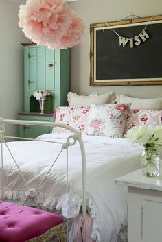 Everything about this room is perfect. The colors the bed frame the jar with the roses the chalkboard <3