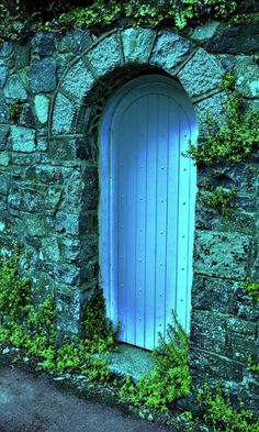 Turquoise door. This looks particularly good because of the slightly blue-tinted stonework around the door