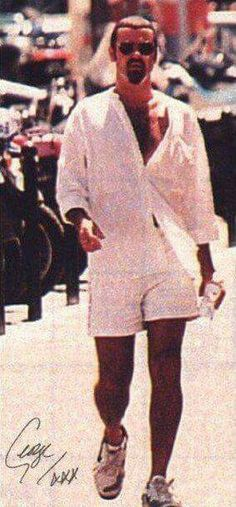 Love those legs. It must have been a hot day. He looks so sweet in white. #GeorgeMichael