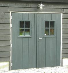 Marvelous garage door carriage - have a look at our short article for even more tips! Garages, Carriage Garage Doors, Shed Doors, Barn Doors, Firewood Shed, Amsterdam Houses, Carport Garage, Wooden Buildings, Bike Shed