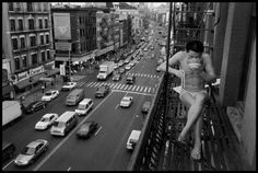 A newly arrived immigrant eats noodles on a fire escape, NYC, 1998. Photographed by Chien-Chi Chang.