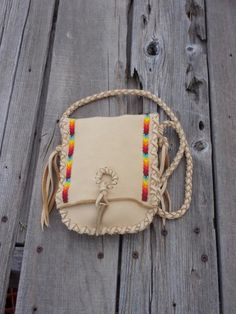 This beaded medicine bag has rainbow beadwork and an antler tip closure on the f. Leather Gifts, Leather Bags Handmade, Leather Pouch, Handmade Bags, Leather Craft, Native American Medicine Bag, Crea Cuir, Native Beading Patterns, Rainbow Bag