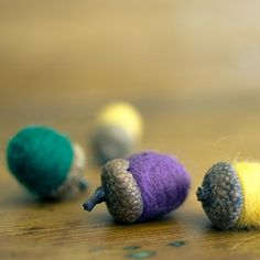This set of 9 (nine) felted wool acorns in lemon yellow, forest green and violet purple is simply beautiful. Sweet handmade ornaments for a bowl, a