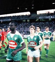 Roger Milla (AS Saint-Étienne, 1984–1986, 59 apps, 31 goals) enters onto Stade Gerland pitch during the famous derby held on the 24 February 1985. Olympique de Lyon vs Saint-Étienne 1-5.
