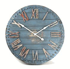 The Blue Wooden Clock Face will make a statement in any room, but will especially add a designer touch to a large family kitchen or great room. The raised Roman numerals and rustic blue finish add the right amount of color and texture. Blue Wall Clocks, White Clocks, Wood Clocks, Rustic Clocks, Vintage Clocks, Metal Clock, Clock Wall, Clock Decor, Wood And Metal
