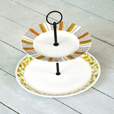 This two-tiered cake stand satiates your sweet tooth and vintage addiction simultaneously. Each level is a piece of repurposed antique china, discovered by Fresh Pastry Stand from a 20th-century decade gone by. Two complementary yet unique plates have been assembled into a stunning tabletop display—with years of bread breaking under its belt.
