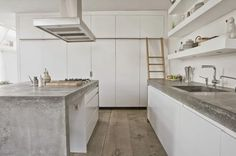 Minimal white cabinets, stark concrete worktops and warm wood, nicely adds balance to the space...  A good combination in thi...