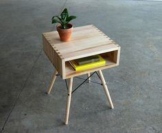 CoMod - The box joint, all maple table top & base is attached to a black powerd coated Eames style dowel legged base.