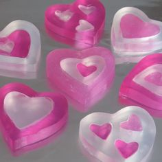 HEART SHAPED SOAPS:  Waxed paper   Loaf pan  Knife   1 to 1 1/2 pounds clear glycerin soap (sold in craft stores Large glass measuring cup or other microwavable container with a pouring spout         Wooden spoon or craft stick       Red soap dye    Pearlescent powder for making opaque soap (optional)     Heart-shaped fondant or cookie cutters (the ones used to make the soaps